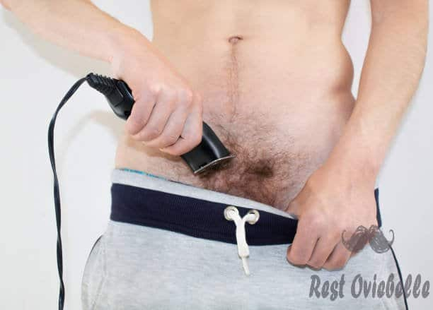a man shaves a pubis with an electric razor - shaver for pubes s and pictures Features Should The Best Shaver For Pubes Have