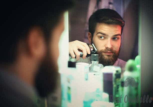 man trimming beard. - electric shaver s and pictures A Step By Step For Using An Electric Shaver For Sensitive Skin