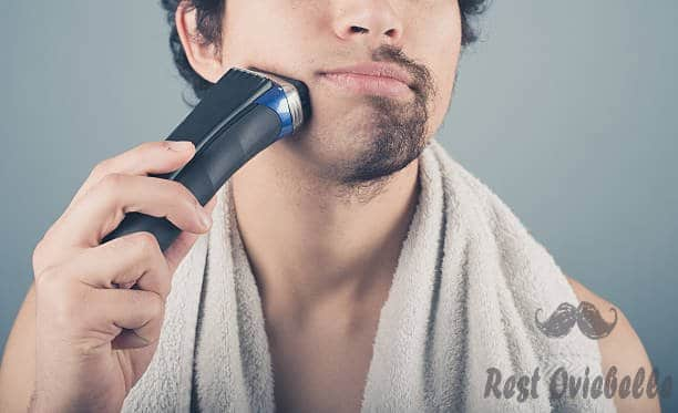 young man shaving half of his beard - electric shaver s and pictures A Step By Step For Using An Electric Shaver For Sensitive Skin
