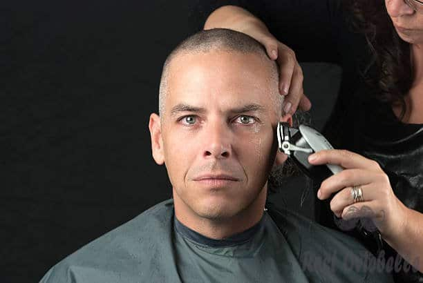 mourning man gets head shaved for fundraiser looks to camera - clippers shaved head men s and pictures Things To Consider Before You Purchase Best Clippers For Shaved Head