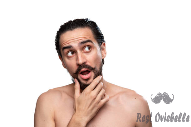 thoughtful handsome bearded man with mustaches standning bare isolated over white background and looking to the camera. concept of morning treatment. morning routine - comb mustache stock pictures royalty-free photos & images
